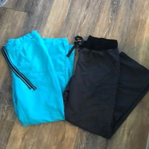 2 pairs of scrub pants. Size M